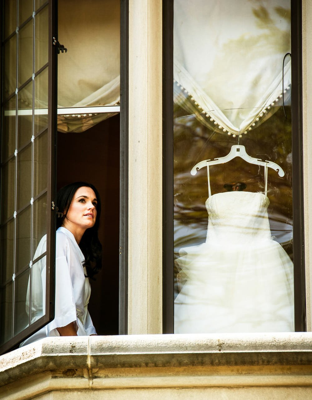 Bride looking out window at Waveny House